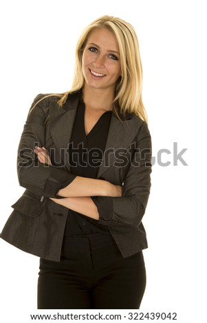 A business woman with a smile on her lips, in her jacket ready for work. - stock photo