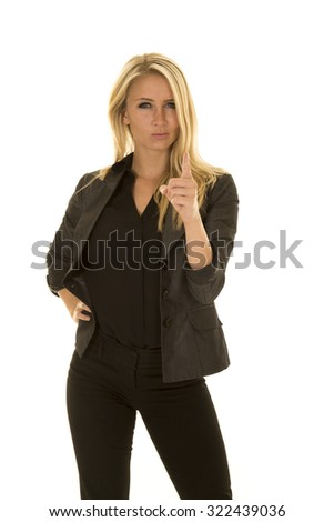 A business woman with an upset expression on her face pointing her finger. - stock photo