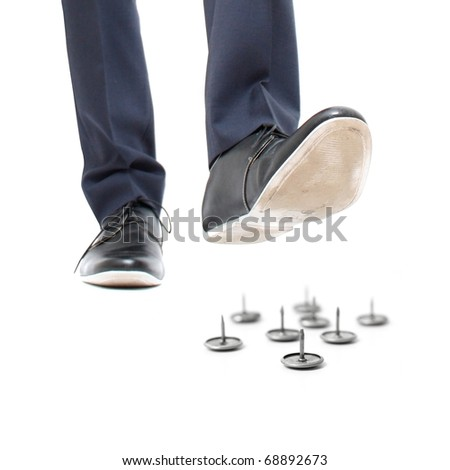 A businessman about to step on needles - stock photo