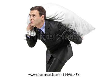 A businessman carrying a money bag isolated on white background - stock photo