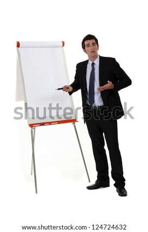 A businessman doing a presentation. - stock photo