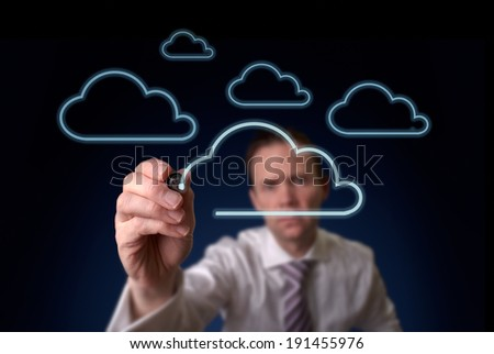A businessman drawing a cloud storgage concept on a clear screen.