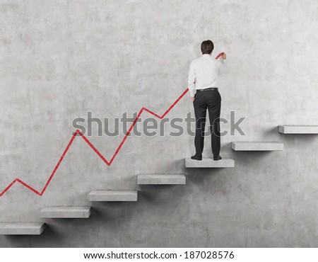 A businessman drawing a graph - stock photo