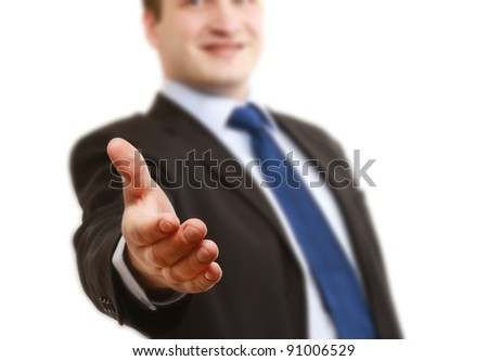 A businessman giving a hand, focus on his hand, isolated on white bakground