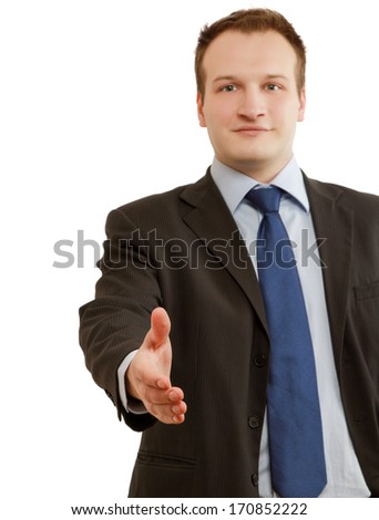 A businessman giving his hand for a handshake - stock photo