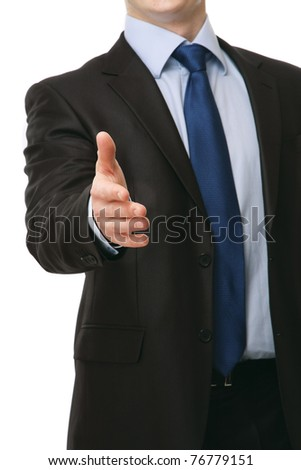 A businessman giving his hand for a handshake, focus on his hand - stock photo