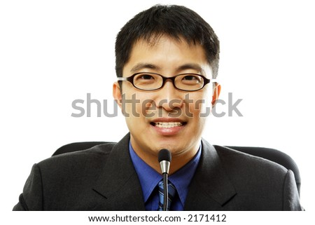 A businessman giving speech with a microphone