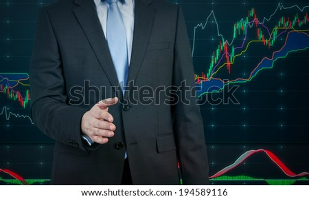 A businessman, handshake and a chart - stock photo