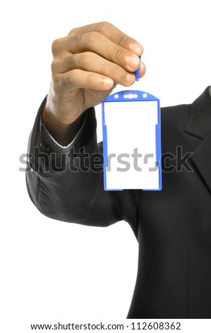 A businessman holding a blank name tag and a sharp business suit. - stock photo