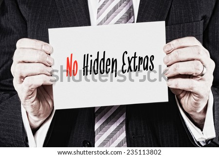 A businessman holding a business card with the words, No Hidden Extras, written on it. - stock photo