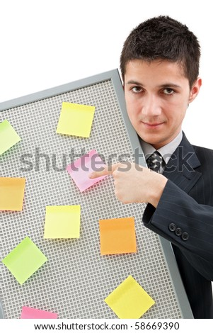 A businessman holding a reminder board with plenty of colorful post-it on it - stock photo