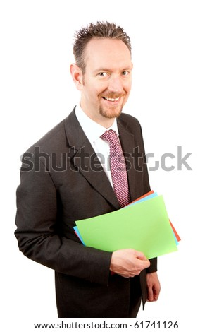 A businessman holds some coloured paper in his hand.  The paper is blank.  Studio isolated on a white background. - stock photo