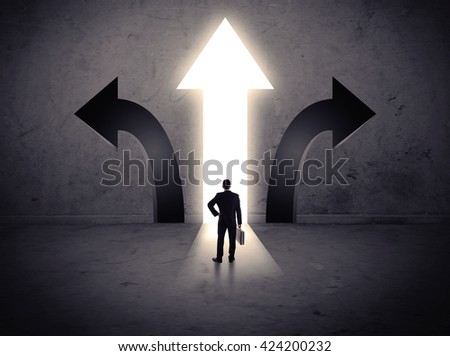 A businessman in doubt, having to choose between three different choices indicated by arrows pointing in opposite direction concept - stock photo