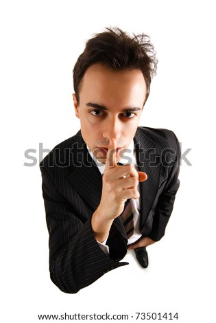 A businessman is asking for silence. Isolated on white. - stock photo
