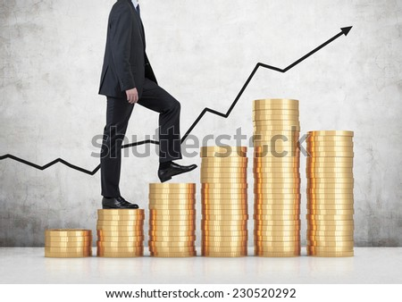 A businessman is going up, coins stair.  - stock photo