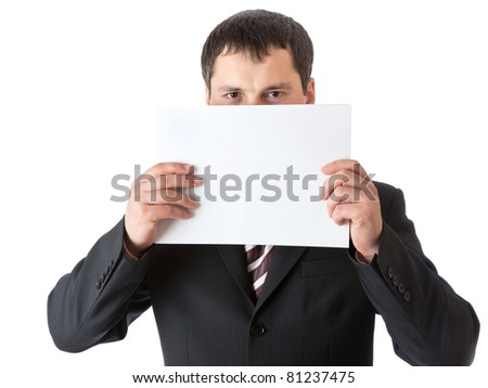 A businessman is holding a blank sheet of paper. Isolated on a white background