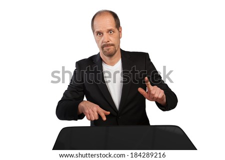 A Businessman is playing on a table with his fingers on a white background. - stock photo