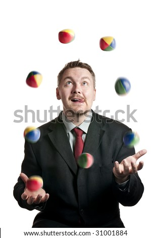 A Businessman juggling balls on white background - stock photo