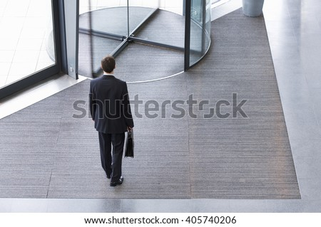 A businessman leaving office - stock photo