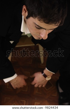 A businessman looks tired, stress in office - stock photo