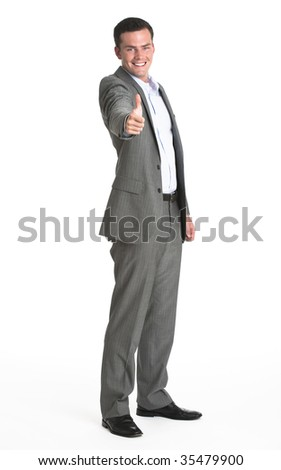 A businessman making a 'thumbs up' gesture.  He is smiling at the camera.  Vertically framed shot.