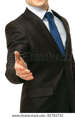 A businessman offering to shake your hand - isolated on a white background - stock photo