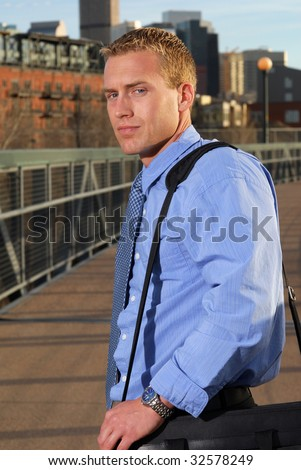 A businessman on a bridge to the city - stock photo