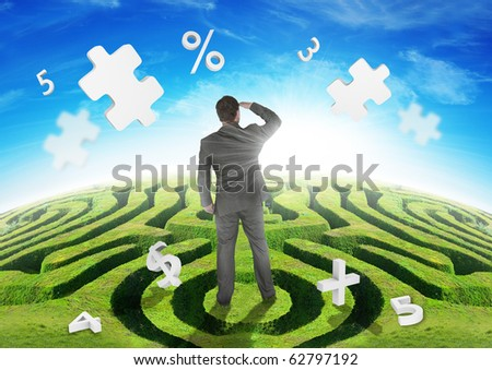 A Businessman on a maze, watching puzzles. - stock photo