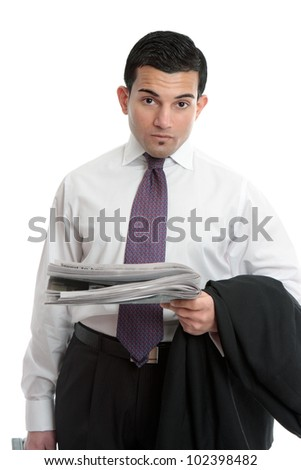 A businessman on the way to work holding the financial newspaper.  White background. - stock photo