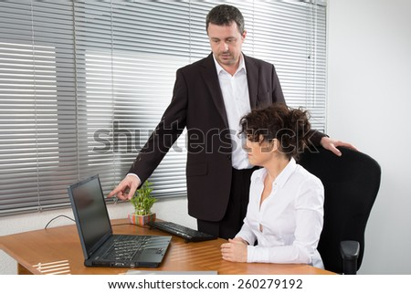 A businessman presenting his product to the woman - stock photo