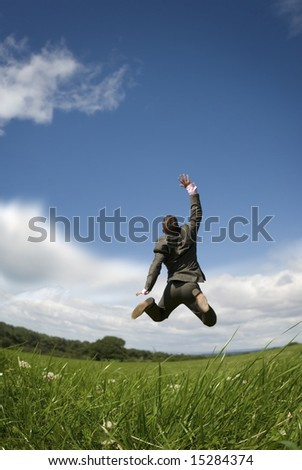 A businessman reaching for the sky! - stock photo