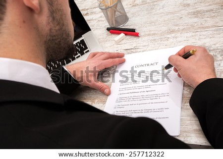 A businessman reading a Contract before signing  - stock photo