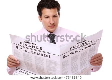 A businessman reading a newspaper - stock photo