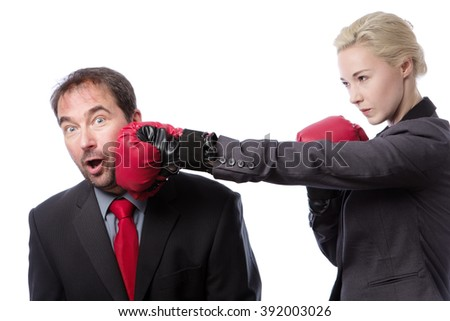 A businessman receiving punch to the side of his head from his co-worker isolated on white background