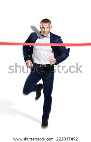 A businessman running at the finish line - stock photo