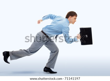 A businessman running in office building - stock photo