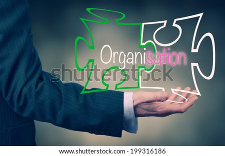 A Businessman's hand holding the word Organisation. - stock photo