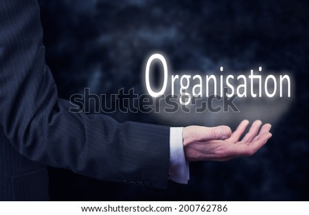 A businessman's hand holding the word, Organisation. - stock photo