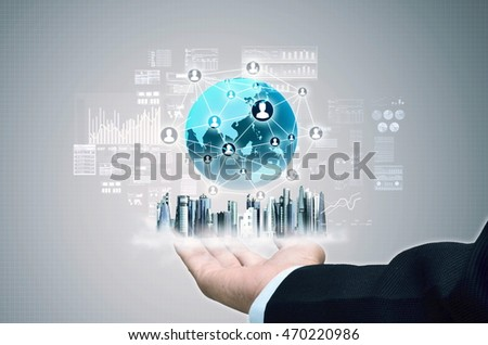 A businessman  show a concept of city and virtual internet business network connection on his hand. A mixed media composed from photo and 3d rendering.
