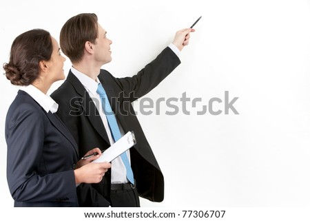 A businessman showing a plan to his colleague
