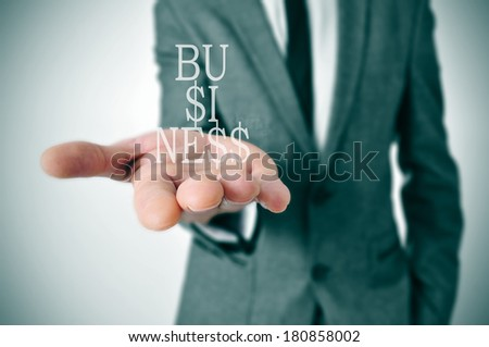 a businessman showing the word business in his hand written with dollar signs instead of esses - stock photo
