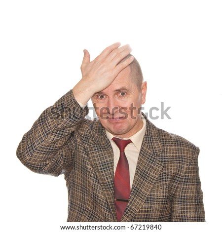 A businessman smacking his forehead. Isolated on white. Body language. Disappointment. Self-accusation. - stock photo