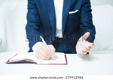 A businessman taking a note