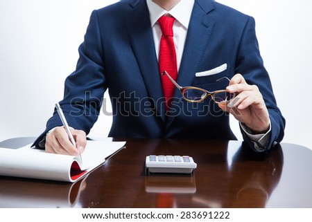 A businessman taking a note - stock photo