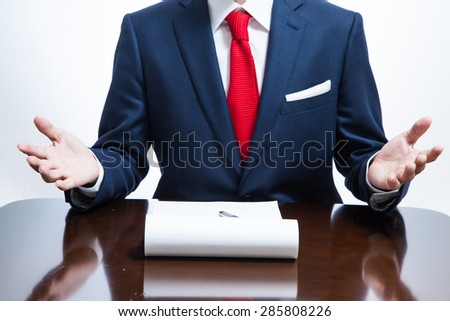 A businessman taking a note with gesture - stock photo