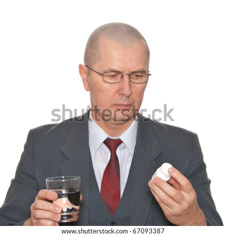 A businessman taking medicine. Isolated on white. - stock photo
