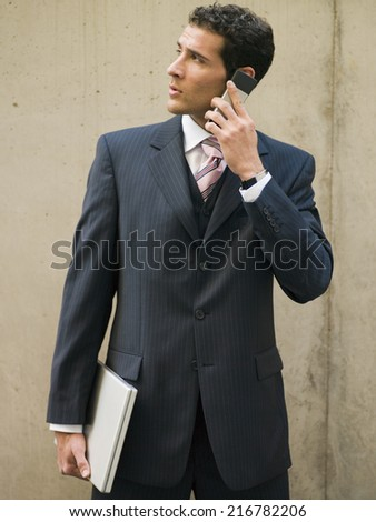 A businessman talking on his mobile phone. - stock photo