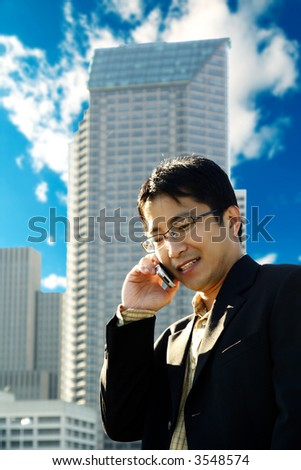 A businessman talking on the phone at a business district - stock photo
