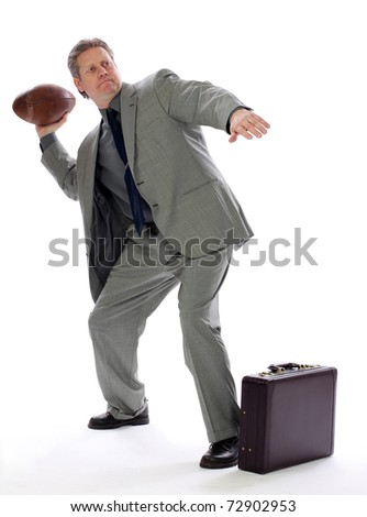 A businessman throwing a football