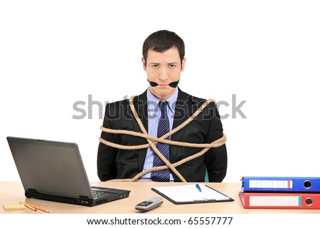 A businessman tied up with rope and gagged with band in the office isolated against white background - stock photo